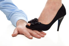 Woman step on the hand Stock Photography