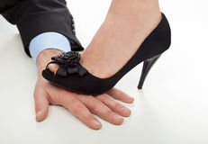 Woman step on the hand Stock Photo