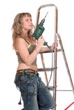 A woman on the stepladder Stock Photos
