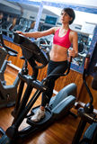 Woman on stepper in gym Stock Photos