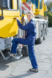 Woman stepping into cab truck Royalty Free Stock Photo