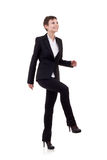 Woman stepping on imaginary step Stock Photography