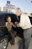 Woman Stepping Out Of Limousine Man Assisting Stock Photos