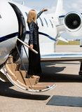 Woman Stepping Out Of Private Jet Royalty Free Stock Photos