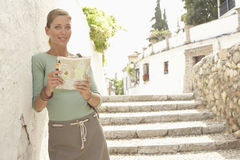 Woman On Steps Reading Map In Granada Stock Photography