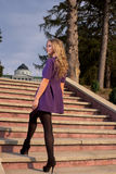 Woman on the steps. Woman in short dress on the steps royalty free stock photography