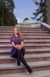 Woman on the steps. Woman in short dress on the steps royalty free stock image