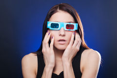 Woman in stereo glasses. Frightened woman in stereo glasses royalty free stock photos