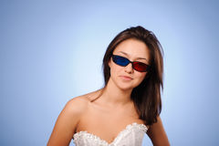 Woman with stereo glasses. Portrait of a beautiful young woman with stereo glasses for three-dimensional movie stock images