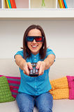 Woman in stereo glasses. Excited woman in stereo glasses watching 3d film royalty free stock images