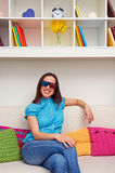 Woman in stereo glasses sitting on sofa Royalty Free Stock Photography