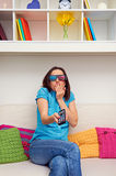 Woman in stereo glasses watching film. Scared woman in stereo glasses watching film Stock Image