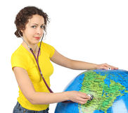 Woman with stethoscope and big inflatable globe Stock Photography
