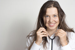 Woman with a stethoscope Royalty Free Stock Images