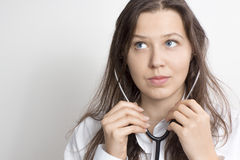 Woman with a stethoscope Stock Images