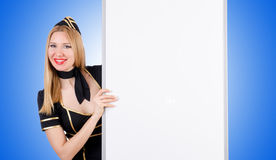 Woman stewardess with blank board Royalty Free Stock Image