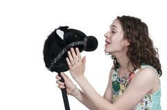 Woman Stick Horse Stock Photography