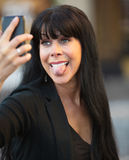 Woman Sticking Out Her Tongue Royalty Free Stock Images