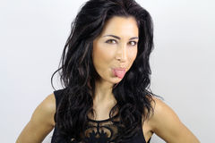 Woman sticking out her tongue Royalty Free Stock Photo