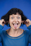 Woman sticking out tongue Royalty Free Stock Photos