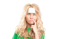 Woman with sticky note on her forehe Royalty Free Stock Photo