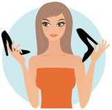 Woman with stilettos. Attractive young woman holding black stilettos Stock Photos
