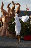 A woman on stilts in robes St. Lucia Stock Photos