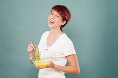 Woman stirring eggs Royalty Free Stock Photography