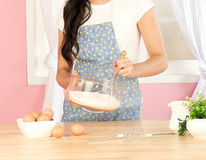 Woman stirring flour Stock Photo