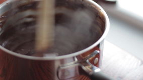 Woman stirring melted chocolate stock video