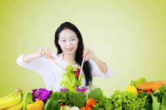 Woman stirring vegetable salad Royalty Free Stock Images