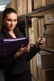 Woman stock counting in warehouse Royalty Free Stock Image