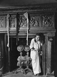 Woman with stockings hanging on hearth. (All persons depicted are no longer living and no estate exists. Supplier grants that there will be no model release Royalty Free Stock Photos