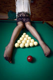 Woman in stockings sitting on billiard table Royalty Free Stock Photos