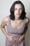 Woman with stomach ache royalty free stock photography