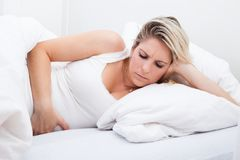 Woman with stomach ache Stock Photos