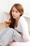 Woman with stomach ache Royalty Free Stock Photos