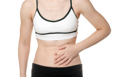 Woman stomach ache in Sports wear Royalty Free Stock Images
