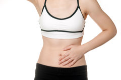 Woman stomach ache in Sports wear Stock Photography