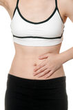 Woman stomach ache in Sports wear Stock Images