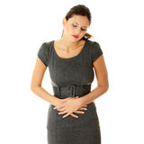 Woman with stomach issues Royalty Free Stock Photography