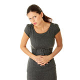 Woman with stomach issues Stock Images