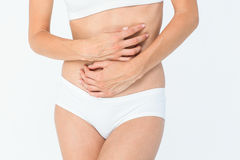 Woman with stomach pain Royalty Free Stock Photography