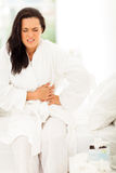 Woman stomach pain Royalty Free Stock Image