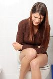 Woman with stomache issues. Young beautiful woman with stomache issues Royalty Free Stock Photo