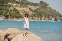 Woman on Stone in sea Royalty Free Stock Image
