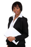 Woman stood with folder. Woman stood with a document folder Royalty Free Stock Image