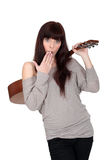 Woman stood holding acoustic guitar Royalty Free Stock Photo