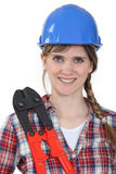 Woman stood holding  tool Stock Photos