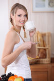Woman stood in the kitchen Royalty Free Stock Images
